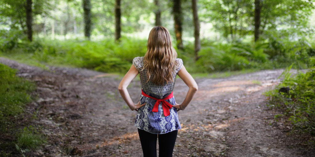 woman at woods crossroads | hfi CAQ: The Career Advice Questionnaire